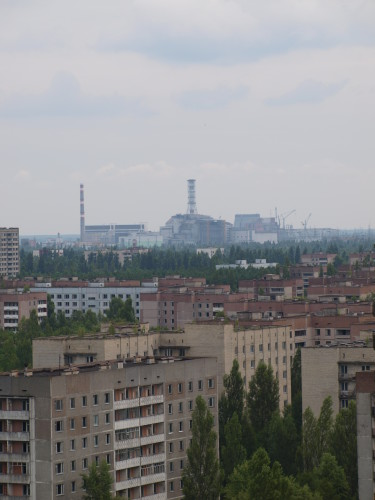 The Chernobyl power plant can be seen in the distance. Photo taken from the roof of a Pripyat apartment building. Photo by Juhana & Maria Pettersson.